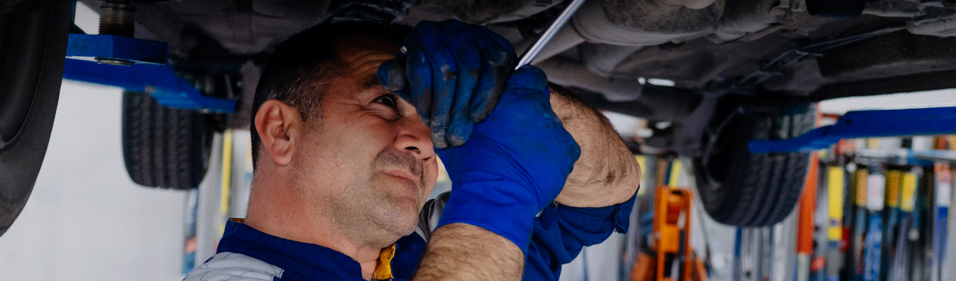 Banner Image used on the Doncaster MOT Website - Shows Car Mechanic at Universal UK MOT Centre Working on a car